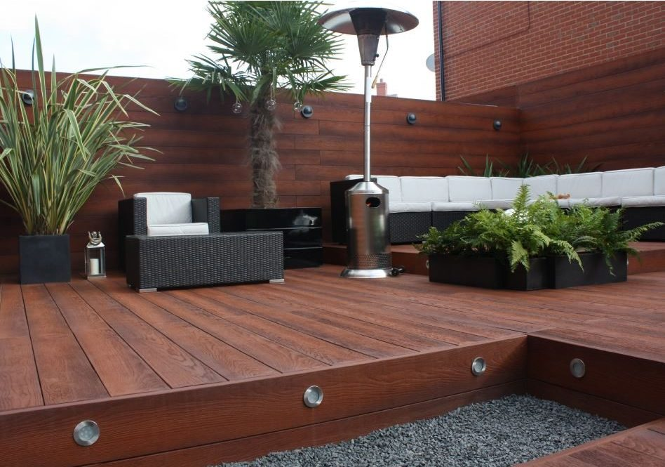 Image of a garden design and garden makeover with composite decking and garden lighting