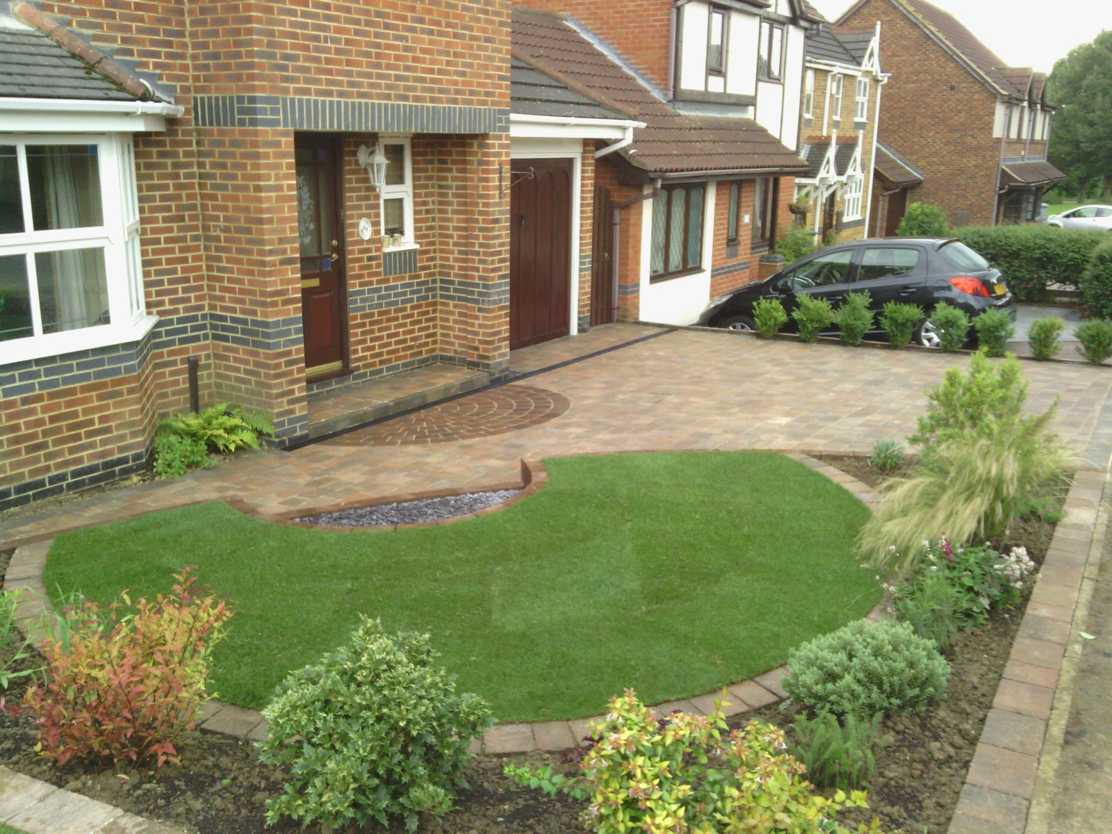 An image of a beautiful block paved driveway with stunning mixed sizes of blocks and attractive terraced garden adjacent to the Driveway
